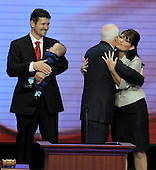 St. Paul, MN - September 3, 2008 -- Governor Sarah Palin of Alaska hugs United States Senator John McCain (Republican of Arizona) as her husband Todd (holding baby Trig) looks on after she accepted the Republican nomination as Vice President of the United States on day 3 of the 2008 Republican National Convention at the Xcel Energy Center in Saint Paul, Minnesota on Wednesday, September 3, 2008.Credit: Ron Sachs / CNP.(RESTRICTION: NO New York or New Jersey Newspapers or newspapers within a 75 mile radius of New York City)