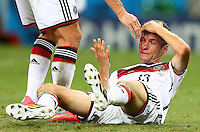 Thomas Muller of Germany goes down injured on the final whistle with a cut to his head