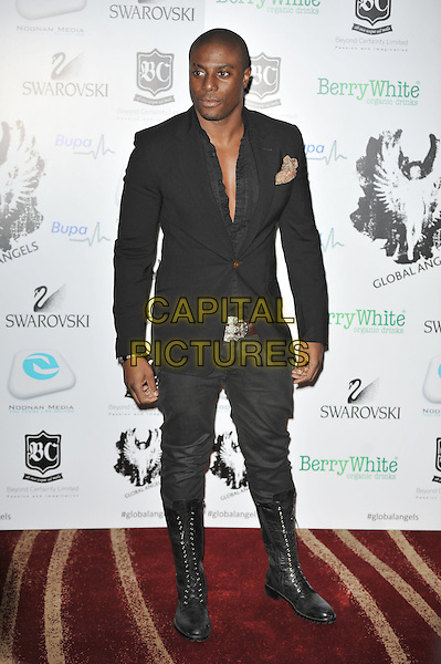 Leo Ihenacho.'Global Angels Awards', The Park Plaza Hotel, Westminster, London, England. 2nd December 2011..full length black jacket shirt undone chest  knee high lace-up boots .CAP/MAR.© Martin Harris/Capital Pictures.