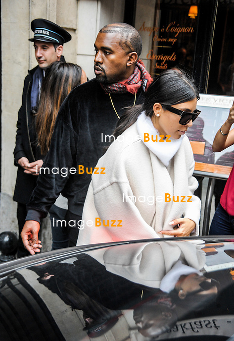 Kim Kardashian and Kanye West arrived in Paris to attend the fashion week.<br /> The couple left the Royal Monceau hotel and went to fBalmain headquarters.<br /> France, Paris, September 24, 2014.<br />  Kim Kardashian et Kanye West &agrave; Paris pour la fashion week.<br /> Kim Kardashian et Kanye West quittent leur h&ocirc;tel, le Royal Monceau, pour se rendre au si&egrave;ge de la maison Balmain &agrave; Paris.<br /> France, Paris, 24 septembre 2014.