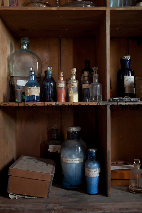 Bottles of developing chemicals in the darkroom