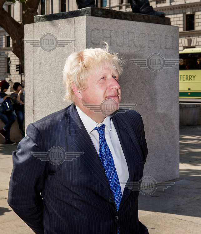 Boris Johnson photographed in front of the Winston Churchill memorial statue in Westminster.