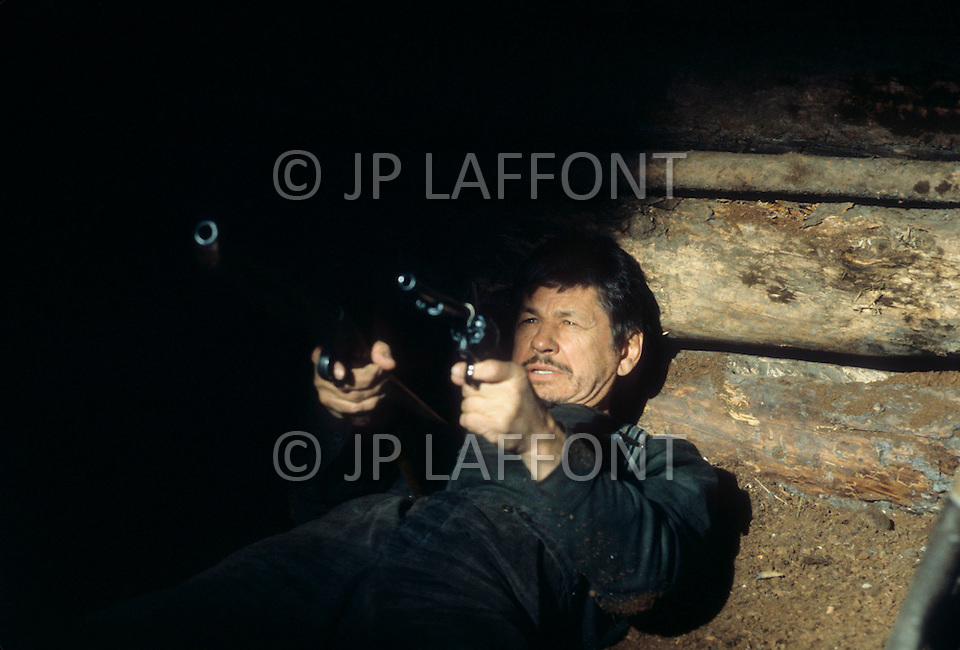 Alberta, Canada - 1980. Picture of actor Charles Bronson on the set of Death Hunt, a 1981 film directed by Peter Hunt, co starring Lee Marvin. Charles Bronson (November 3, 1921 - August 30, 2003) was an American film and television actor, best known for his roles in Once Upon a Time, The Magnificent Seven, The Dirty Dozen and the Great Escape.