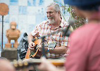 NWA Democrat-Gazette/J.T. WAMPLER Jim Mills of Fayetteville plays in a song circle during the Terra Studios Fall Music and Art Festival Sunday Sept. 9, 2018. The festival included song circles, heritage folk arts, local craft vendors, live art demonstrations and food trucks. More than 500 people attended the event. For more information about Terra Studios visit www.terrastudios.com
