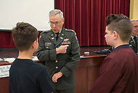 NWA Democrat-Gazette/SPENCER TIREY<br /> Jack King a retired Army Lieutenant Colonel that was in the service 20 years and served in Vet Nam answers question about his badges by 6th graders, Friday March 16, 2018,  at Hellstern Middle School in Springdale. King along with other veteran with the Northwest Arkansa Chapter of the Military Officers Association of America spoke to the school about flag etiquette and answered questions about serving in the military.