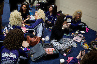 Members of the Celtic Steps team of Colorado Springs, Colorado, get their makeup, wigs, and costumes ready before competition at the 2013 World Championships for Irish Dancing in Boston, Massachusetts, USA.  The 2013 competition in Boston is the second time in the competition's 43-year history that the event has been held in the United States.