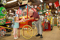 Young girl recieves popcorn at the Moorestown Hardware store, Moorestown, New Jersey