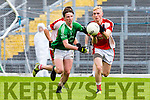 Rathmore Conor Jenkins beats Vincent Horan St Kierans to the loose ball at the SFC clash in Fitzgerald Stadium on Sunday