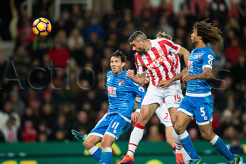19.11.2016. Bet365 Stadium, Stoke, England. Premier League Football. Stoke City versus AFC Bournemouth. Stoke City forward Jonathan Walters heads the ball towards the goal as Bournemouth defender Charlie Daniels watches on.