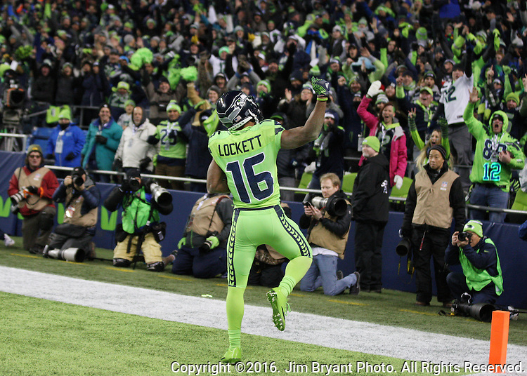 Seattle Seahawks wide receiver Tyler Lockett (16) celebrates with 57-yard touchdown pass against the Los Angeles Rams with fans in the fourth quarter at CenturyLink Field in Seattle, Washington on December 15, 2016.  The Seahawks beat the Rams 24-3.  ©2016. Jim Bryant Photo. All Rights Reserved