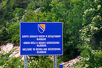 The border crossing between Montenegro and Bosnia-Herzegovina. Sign saying 'Welcome' Klobuk. Trebinje region. Republika Srpska. Bosnia Herzegovina, Europe.