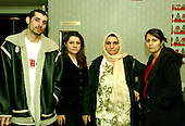 McLean, VA - December 13, 2005 -- Family of Fatima Youssif who emigrated to Binghamton, New York from Duhua, Iraq to escape being gassed by Saddam Hussein.  From left to right: Heshar Audel, Shoresh Audel, Fatima Youssif, and Shraen Ababkir..Credit: Ron Sachs / CNP.(RESTRICTION: NO New York or New Jersey Newspapers or newspapers within a 75 mile radius of New York City)