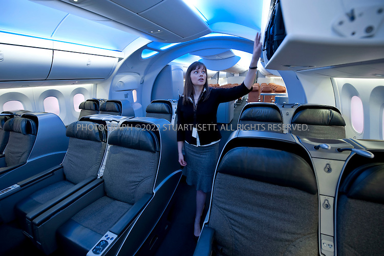 10/23/2009--Renton, WA, USA..Boeing employee, Colleen Rainbolt explains the design of the interior cabin mockup of the Boeing 787 Dreamliner at the Boeing Customer Experience Center...©2009 Stuart Isett. All rights reserved.