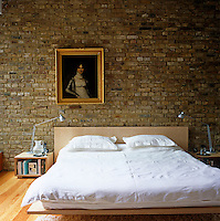 Douglas fir floorboards are laid in all the bedrooms and the bed in the main bedroom was designed by the architect