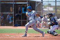 AZL Royals catcher Stephan Vidal (13) follows through on his swing in front of catcher Rainier Aguilar (8) during an Arizona League game against the AZL Padres 1 at Peoria Sports Complex on July 4, 2018 in Peoria, Arizona. The AZL Royals defeated the AZL Padres 1 5-4. (Zachary Lucy/Four Seam Images)