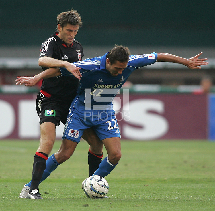 July 9, 2005: Washington, DC.  Kansas City Wizards forward Davy Arnaud (22) is fouled by DC United defender Brandon Prideaux (4) at RFK Stadium.
