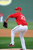 Pitcher Jamie Callahan (23) of the Greenville Drive works on a pitcher's drill during a Media Day first workout of the season on Tuesday, April 7, 2015, at Fluor Field at the West End in Greenville, South Carolina. (Tom Priddy/Four Seam Images)