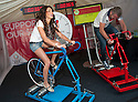 Miss Scotland 2013, Jamey Bowers, takes part in the cycle challenge against Andrew Bell from Elgin as the Glasgow 2014 Commonwealth Games 1 year countdown begins.