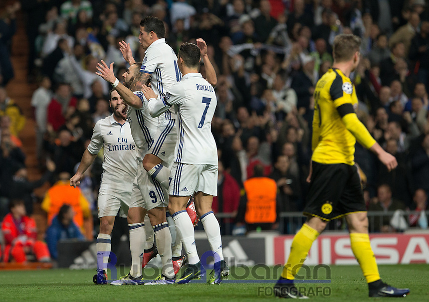 Real Madrid's French forward Karim Benzema celebrating after scoring during the UEFA Champions League match between Real Madrid and Borussia Dortmund at the Santiago Bernabeu Stadium in Madrid, Tuesday, December 7, 2016.