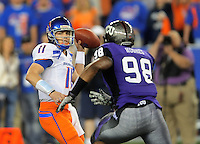 Jan. 4, 2010; Glendale, AZ, USA; Boise State Broncos quarterback (11) Kellen Moore looks to pass under pressure from TCU Horned Frogs defensive end (98) Jerry Hughes in the first quarter in the 2010 Fiesta Bowl at University of Phoenix Stadium. Mandatory Credit: Mark J. Rebilas-