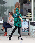 October 18th 2012 <br /> <br /> <br /> Sofia Vergara filming the tv show Modern Family at the Magnolia Bakery in Los Angeles. Sofia was taking pictures with her camera cell phone laughing smiling. Showing a big fake pregnant baby bump wearing a green dress carrying a big white box with a cake inside for the scene <br /> <br /> <br /> AbilityFilms@yahoo.com<br /> 805 427 3519<br /> www.AbilityFilms.com