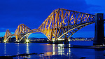 The illuminated and freshly repainted Forth Rail Bridge, Edinburgh, Scotland...The iconic bridge is 2.5 km. (1.5 mile) long and is one of the world's great feats of engineering. Work on the bridge began in 1883 and was formally completed on 4 March 1890 when HRH Edward, Prince of Wales tapped a 'golden rivet' into place...Picture: Malcolm McCurrach - 04/04/2012