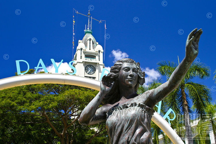 A Hula Dancer statue welcomes shoppers drawn to a wide variety of fashion and unique gift choices at the Aloha Tower Marketplace located near downtown Honolulu, Oahu.