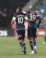 New England Revolution midfielder Juan Agudelo (10) celebrates his goal with assist from New England Revolution substitute forward Saer Sene (39). In a Major League Soccer (MLS) match, the New England Revolution (blue) defeated Toronto FC (red), 2-0, at Gillette Stadium on May 25, 2013.