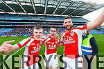 Timmy Finnegan, Mike Finneganand Dave Curtin Brosna players celebrate after winning the Junior Football All Ireland Club Final in Croke Park on Saturday.