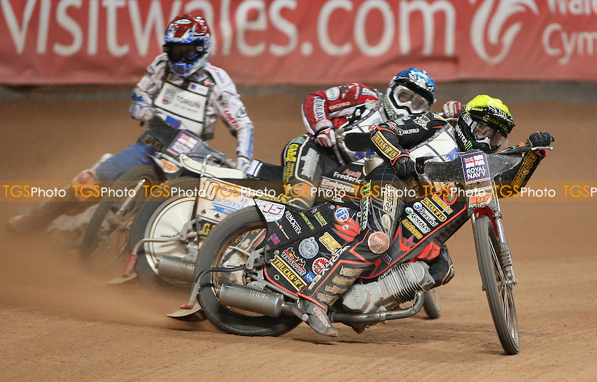 Heat 19: Tai Woffinden (yellow), Hans Andersen (blue) and Nicki Pedersen (red) - British Speedway Grand Prix at the Millennium Stadium, Cardiff - 10/07/10 - MANDATORY CREDIT: Rob Newell/TGSPHOTO - Self billing applies where appropriate - 0845 094 6026 - contact@tgsphoto.co.uk - NO UNPAID USE.