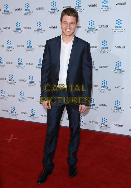 "BEN McKENZIE (Benjamin McKenzie).TCM Classic Film Festival - ""A Star Is Born"" - Arrivals held at Grauman's Chinese Theatre, Hollywood, California, USA, 22nd April 2010..full length navy blue suit white shirt smiling .CAP/ADM/TC.©T. Conrad/AdMedia/Capital Pictures."