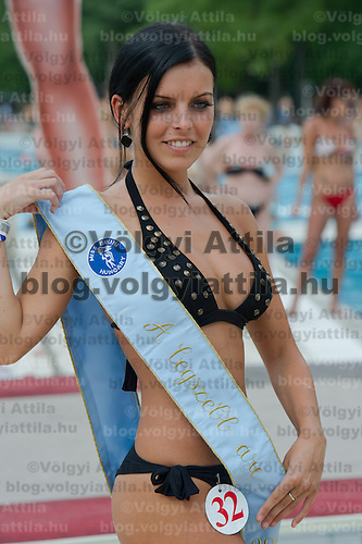Evelin Szalai poses for photographers as the winer of the best face award during the Miss Bikini Hungary beauty contest held in Budapest, Hungary on August 06, 2011. ATTILA VOLGYI