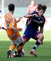 New England Revolution midfielder (27) Wells Thompson and Houston Dynamo defender (24) Wade Barrett. The Houston Dynamo defeated the New England Revolution 2-1 in the finals of the MLS Cup at RFK Memorial Stadium in Washington, D. C., on November 18, 2007.