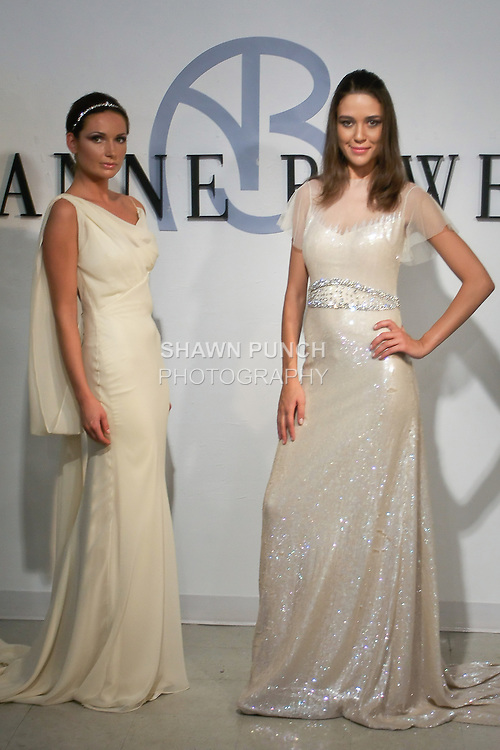 """Models pose in a Bridal gown from the Anne Bowen Bridal Spring 2013 """"Coat of Arms"""" collection fashion show, during Bridal Fashion Week New York April 2012."""
