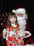 Hannah Finnegan pictured with Santa at Ballapoosta christmas fair. Photo: Colin Bell/pressphotos.ie