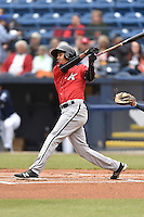 Kannapolis Intimidators shortstop Johan Cruz (20) swings at a pitch during a game against the Asheville Tourists at McCormick Field on May 19, 2016 in Asheville, North Carolina. The Intimidators defeated the Tourists 10-7. (Tony Farlow/Four Seam Images)