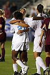 07 November 2008: North Carolina's Nikki Washington (26) is hugged by Tobin Heath (behind) with Yael Averbuch (right) after scoring a goal. The University of North Carolina Tarheels defeated Boston College Eagles 2-0  at WakeMed Stadium at WakeMed Soccer Park in Cary, NC in a women's ACC tournament semifinal game.