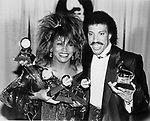 TINA TURNER  4 Grammy Awards 1985  Los Angeles here with Lionel Richie and his award