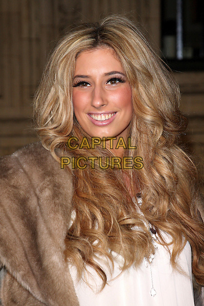 STACEY SOLOMON.Attending the Gala VIP Opening Night of Cirque du Soleil's 'Varekai' at the Royal Albert Hall, London, England, UK, .January 5th 2010..arrivals portrait headshot eyelashes make-up false smiling bronzer brown fur .CAP/ROS.©Steve Ross/Capital Pictures.