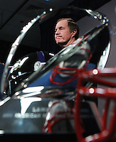 Foxboro, MA  -   Framed by the Lamar Hunt AFC Championship trophy,  New England Patriots head coach Bill Belichick speaks to the media at Gillette Stadium on Wednesday, January 18, 2012. Staff Photo by Matthew West.