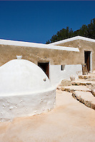 The large round structure next to the kitchen door is the old bread oven