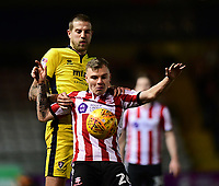 Lincoln City's Harry Anderson shields the ball from Cheltenham Town's Harry Pell<br /> <br /> Photographer Chris Vaughan/CameraSport<br /> <br /> The EFL Sky Bet League Two - Lincoln City v Cheltenham Town - Tuesday 13th February 2018 - Sincil Bank - Lincoln<br /> <br /> World Copyright &copy; 2018 CameraSport. All rights reserved. 43 Linden Ave. Countesthorpe. Leicester. England. LE8 5PG - Tel: +44 (0) 116 277 4147 - admin@camerasport.com - www.camerasport.com