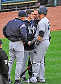 New York Yankees catcher Gary Sanchez (24) is attended to by the team's training staff and manager Joe Girardi (28) after injuring himself swinging the bat in the top of the fifth inning against the Baltimore Orioles at Oriole Park at Camden Yards in Baltimore, MD on Saturday, April 8, 2017.  Sanchez left the game.  The Orioles won the game 5 - 4.<br /> Credit: Ron Sachs / CNP<br /> (RESTRICTION: NO New York or New Jersey Newspapers or newspapers within a 75 mile radius of New York City)