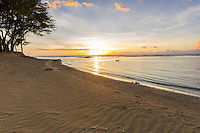 A relaxing sunset beach scene in Puako, Big Island of Hawai'i.