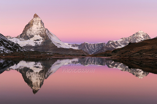 Matterhorn at sunrise in winter with reflection in the Riffelsee, Zermatt, Valais, Switzerland, Europe