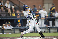 Michigan Wolverines shortstop Michael Brdar (9) swings the bat against the Michigan State Spartans on May 19, 2017 at Ray Fisher Stadium in Ann Arbor, Michigan. Michigan defeated Michigan State 11-6. (Andrew Woolley/Four Seam Images)