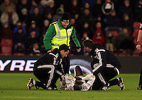 Pictured: Modou Barrow of Swansea injured on the ground is seen by his team's physio and doctor before stretchered off Sunday 01 February 2015<br /> Re: Premier League Southampton v Swansea City FC at ST Mary's Ground, Southampton, UK.
