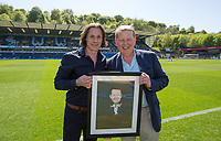 Wycombe Wanderers Manager Gareth Ainsworth presents BBC Presenter & Wycombe supporter Bill Turnbull with a photo during the Sky Bet League 2 match between Wycombe Wanderers and Stevenage at Adams Park, High Wycombe, England on 5 May 2018. Photo by Andy Rowland.