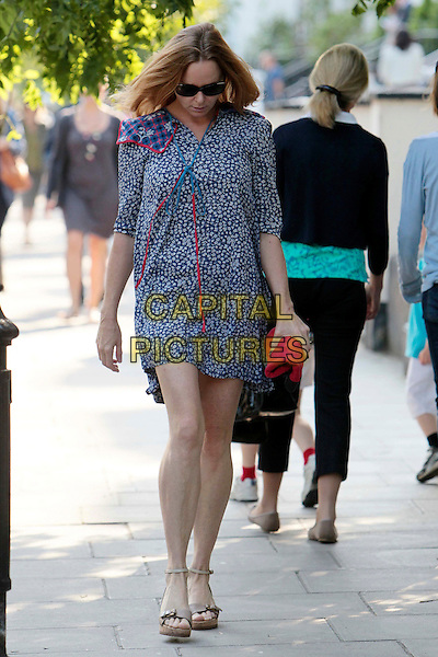 Stella McCartney spotted in Notting Hill,.London, England..July 4th, 2011.full length blue floral print dress beige sandals shoes sunglasses shades looking down.CAP/HIL.©John Hillcoat/Capital Pictures.