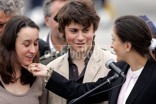 Former hostage Ingrid Betancourt embraces her son Lorenzo, right, and daughter Melaine upon their arrival at a military base in Bogota